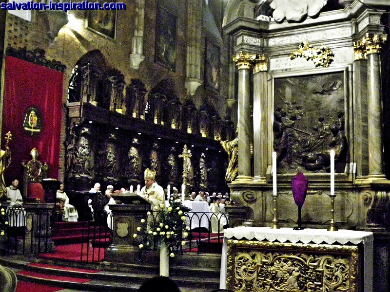 Cross veiled during Passiontide in Lent 2015. Statues and images remain ucovered. The Chrism Mass  celebrated by archbishop Jozef Kupny on Maundy Thursday in Saint John the Baptist Archcathedral, Wroclaw, Poland