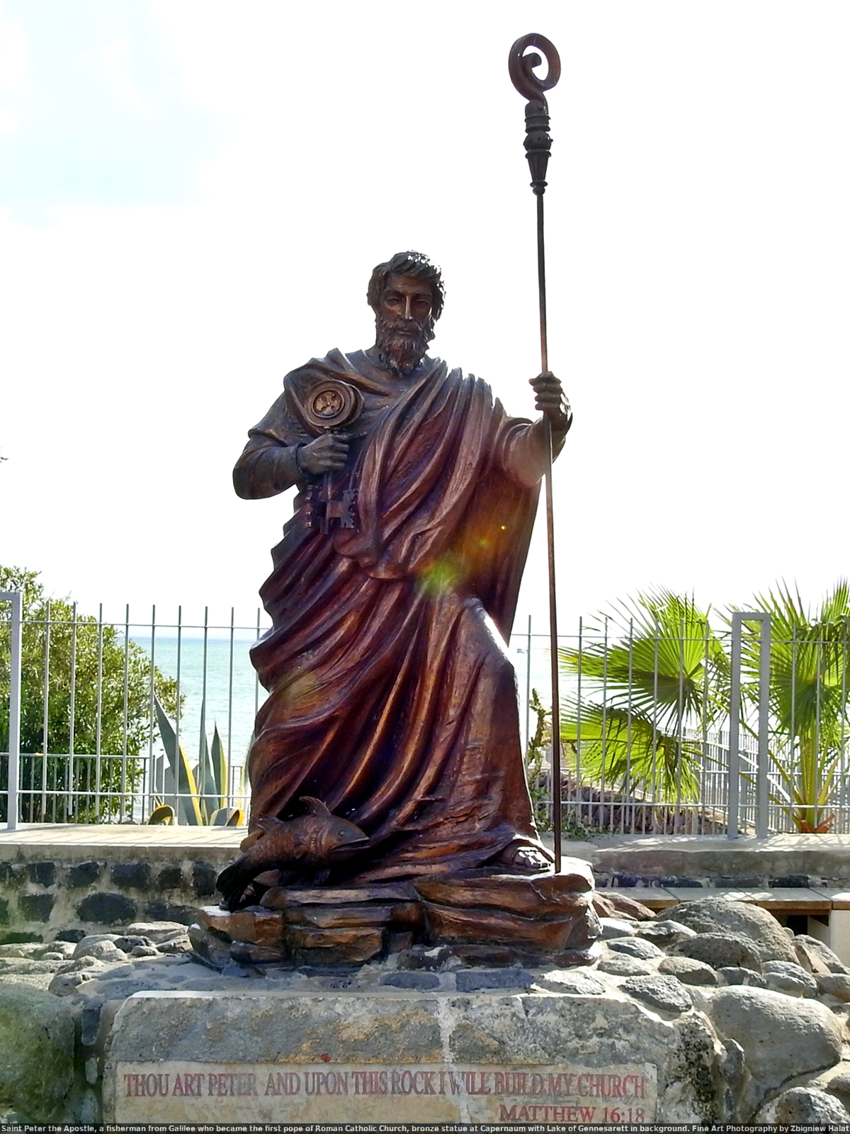 "Saint Peter the Apostle, a fisherman from Galilee who became the first pope of Roman Catholic Church, bronze statue at Capernaum with Lake of Gennesarett in background. Fine Art Photography by Zbigniew Halat. 18 ""And I tell you that you are Peter. On this rock I will build My church. The powers of hell will not be able to have power over My church. Matthew 16:18"