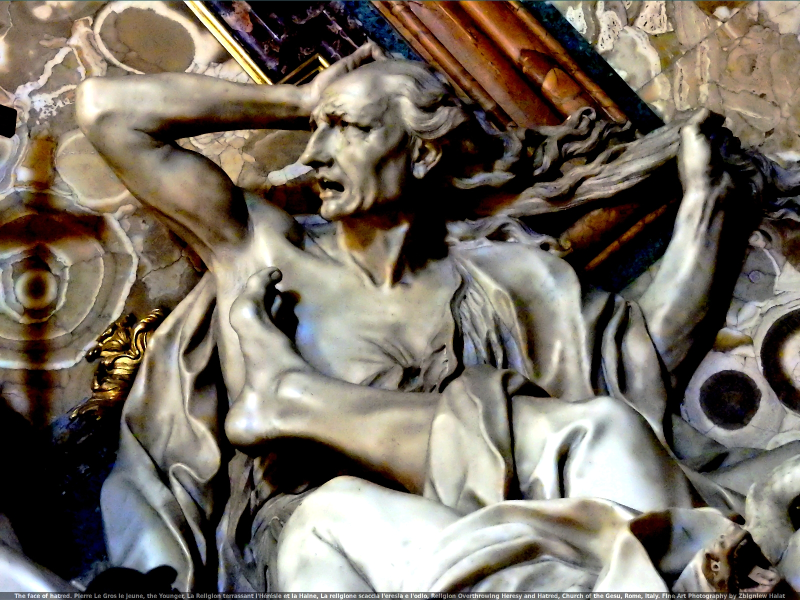 The face of hatred. Pierre Le Gros le jeune, the Younger, La Religion terrassant l'Hérésie et la Haine, La religione scaccia l'eresia e l'odio, Religion Overthrowing Heresy and Hatred, Church of the Gesù, Rome, Italy. Fine Art Photography by Zbigniew Halat